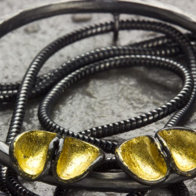 Oxidised silver and gold leaf round cluster pendant