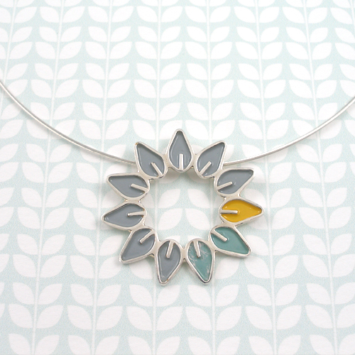 Solid leaf circle on wire by Emma Leonard
