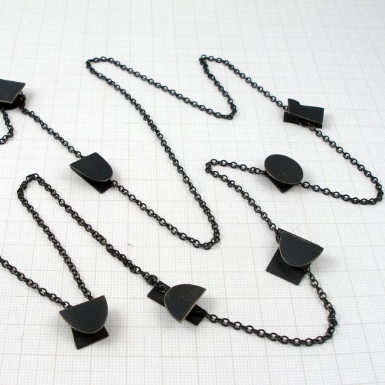 Long oxidised silver 8 shapes necklace by Annabet Wyndham