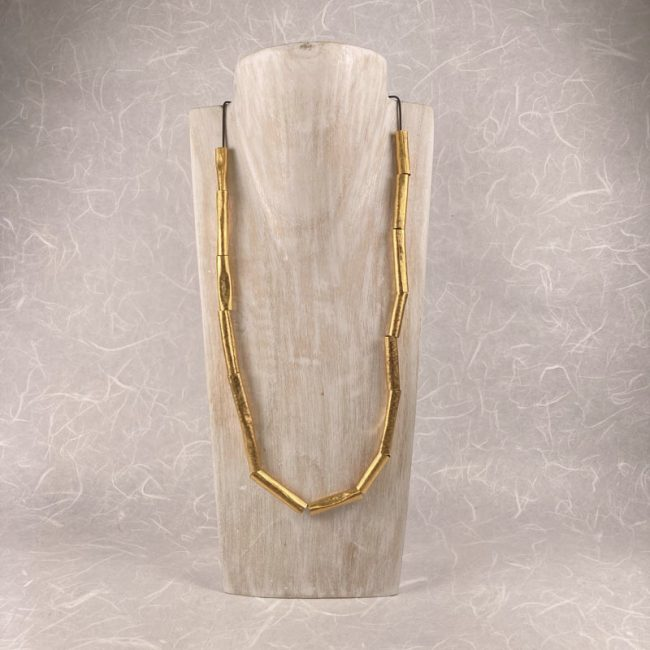 Gold plated Tubes necklace by Hilary Brown