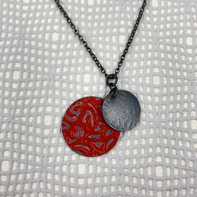 Alyssa disc pendant in red aluminium and oxidised silver, by Penny Warren