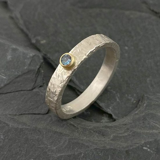 Textured silver ring with 18ct gold and aquamarine by Jenifer Wall