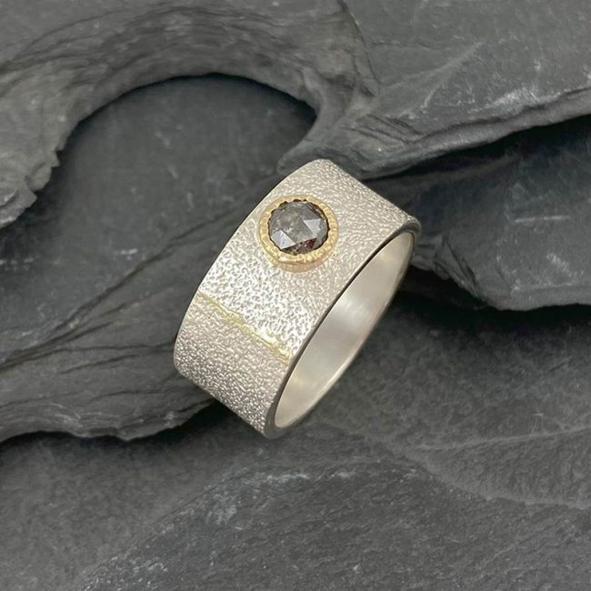 Silver and 18ct gold seam ring with salt & pepper rosecut diamond by Jenifer Wall
