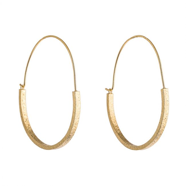 Gold plated, large, textured hoop earrings by Lucy Thompson