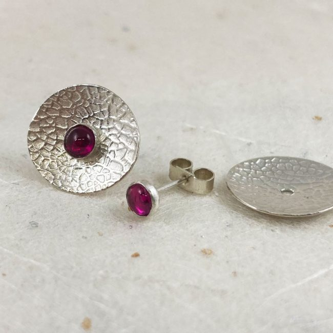 Textured silver concave disc earrings with detachable ruby studs by Rebecca Halstead