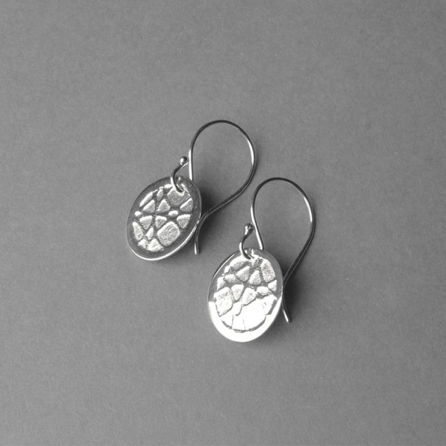 Textured silver oval drop earrings by Rebecca Halstead