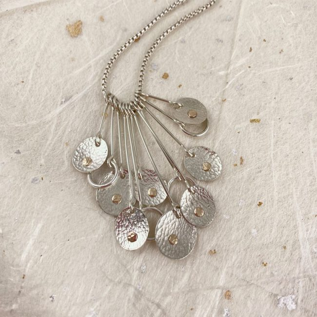 Silver & 14ct gold filled textured ovals drop pendant by Rebecca Halstead