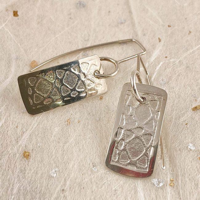 Textured silver rectangular drop earrings by Rebecca Halstead