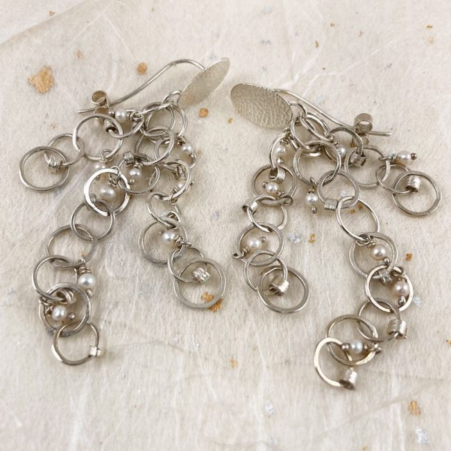 Textured silver multi drop earrings with tiny scrolls and freshwater pearls by Rebecca Halstead