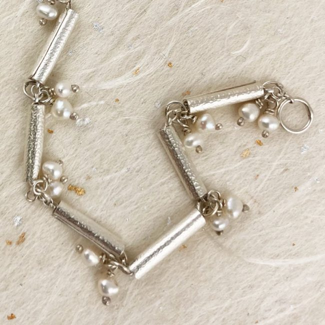 Silver textured scrolls bracelet with freshwater pearls by Rebecca Halstead