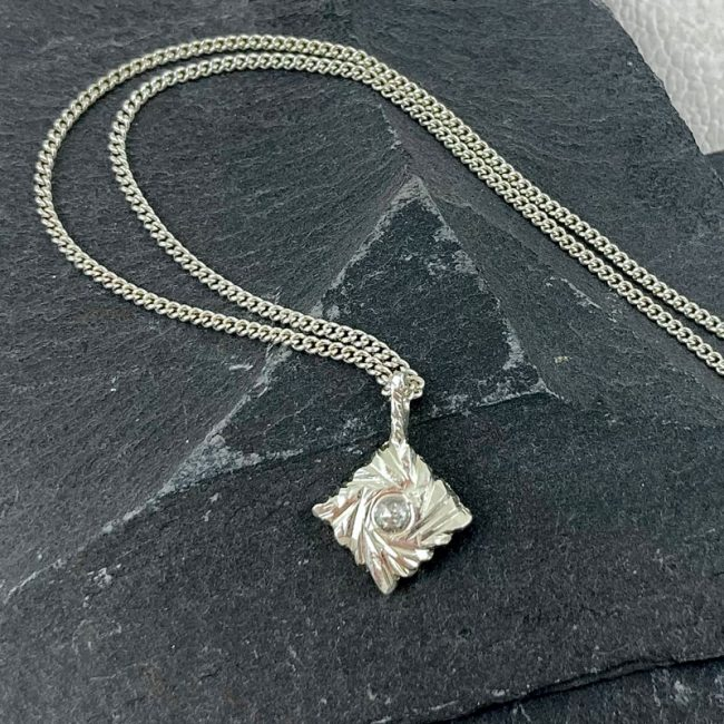 Carved Square Rocks silver pendant with salt and pepper diamond by Hannah Felicity Dunne