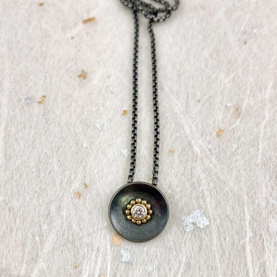 Oxidised silver disc pendant with white diamond and 18ct gold granules by Jenifer Wall