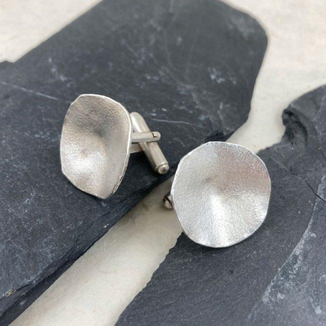 Textured silver concave disc cufflinks by Samantha Maund